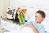 Boy resting in hospital bed