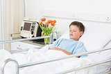 Boy sleeping in hospital ward