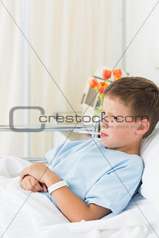 Boy with thermometer in mouth