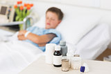 Medicines on table with boy in bed