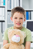 Boy with teddy bear in clinic