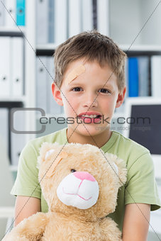 Boy with teddy bear in clinic