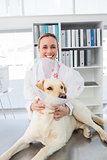 Veterinarian with dog wearing medical collar