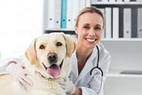 Confident female veterinarian with dog