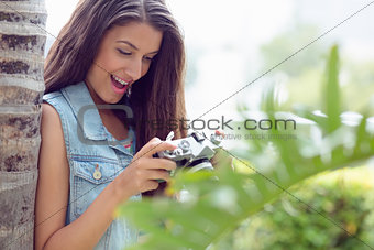 Stylish happy girl looking at her camera