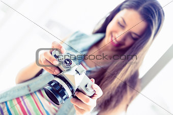 Smiling brunette looking at her camera