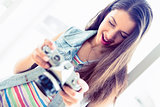 Cheerful brunette looking at her camera
