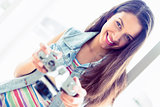 Cheerful brunette holding her camera