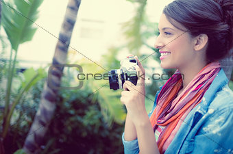 Smiling brunette taking a photo