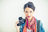 Beautiful brunette holding camera smiling