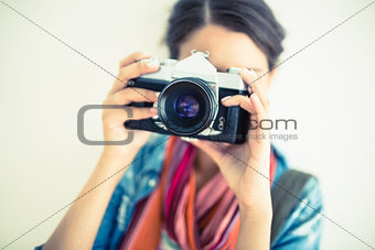 Attractive brunette holding camera up