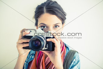Attractive brunette taking a photo