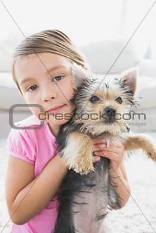 Little girl holding her yorkshire terrier puppy