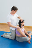 Masseur massaging pregnant womans head and neck