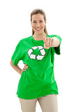 Smiling woman in recycling symbol t-shirt pointing at camera
