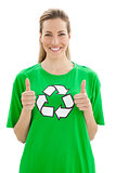 Woman in recycling symbol t-shirt gesturing thumbs up