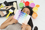 Woman with paint samples and paintbrush