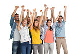 Group of casual happy young people raising hands