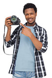 Portrait of a happy man pointing at his camera