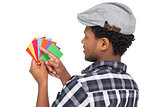 Side view of a young man looking at colorful papers
