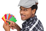 Portrait of a young man with colorful papers