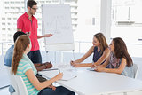 Man giving presentation to casual team in office