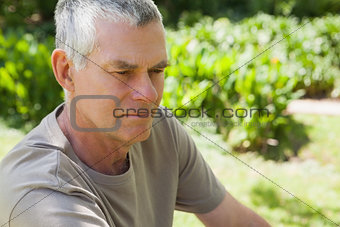 Thoughtful mature man at the park