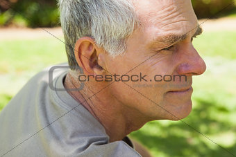 Thoughtful mature man at park