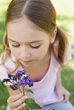 Close-up of girl holding flowers at park