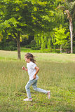 Side view of a young girl running at park
