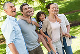 Cheerful extended family standing at park