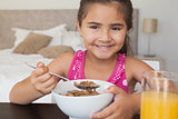 Close-up portrait of a girl having breakfast