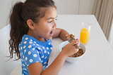 Side view of a girl having breakfast