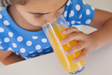 Close-up of a girl drinking orange juice