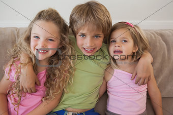 Portrait of happy young kids in living room