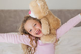Young happy girl with stuffed toy
