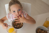 High angle portrait of a girl having breakfast