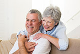 Retired couple embracing