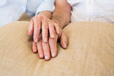 Retired couple holding hands