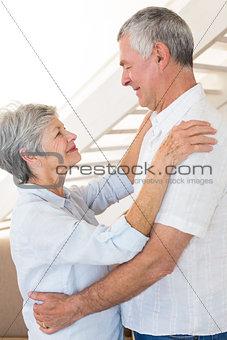 Affectionate senior couple dancing together