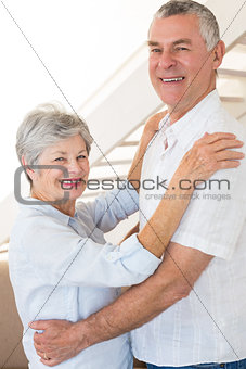 Affectionate senior couple dancing together