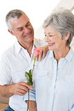 Senior man offering a rose to his partner