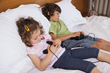 Asleep siblings while playing video games in bedroom