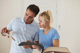 Couple looking at color book in new house