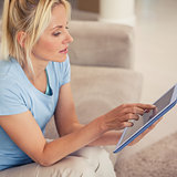 Young woman using digital tablet in living room