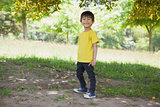 Full length portrait of a happy boy at park