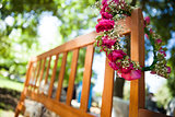 Flower wreath on a wooden bench at park