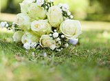 Bridal bouquet on grass at the park