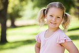 Portrait of a smiling young girl at park