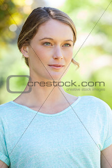 Beautiful serious woman looking away in park